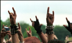 NIJMEGEN, NETHERLANDS - 5th JUNE: Heavy Metal Rock fans and audience hold their hands in the air at the Dynamo Rock Festival in Nijmegen, Netherlands on 5th June 2004. (Photo by Paul Bergen/Redferns)
